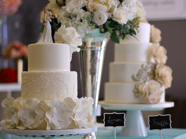 Wedding Cakes on Display with a metal vase